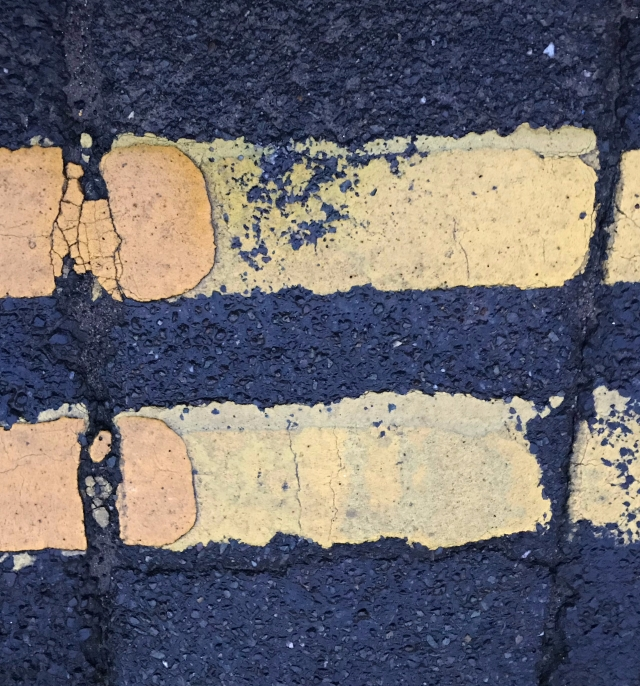 Just an image of double yellow lines looking like an equals sign